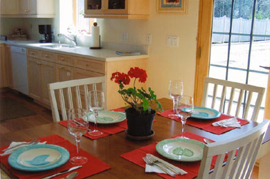 Chatham Cape Cod vacation rental - Dining area with patio doors facing south to garden & lawn