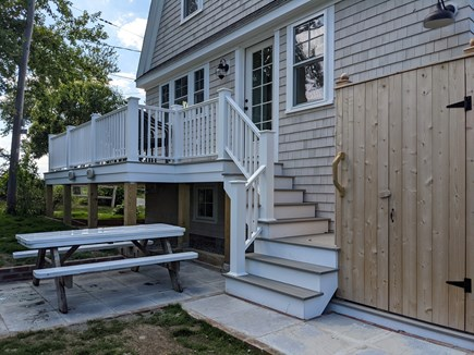 Chatham's Old Village Cape Cod vacation rental - Seating and outdoor shower area