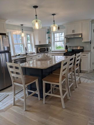Chatham's Old Village Cape Cod vacation rental - Bright and Airy fully applianced kitchen with waterviews