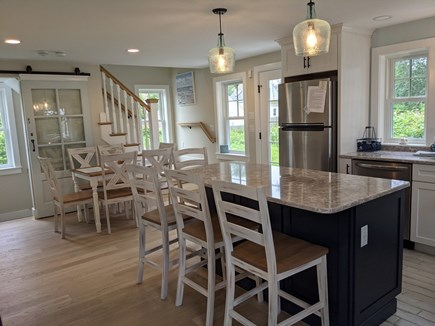 Chatham's Old Village Cape Cod vacation rental - Dining area with sliding Barn Door to the finished basement