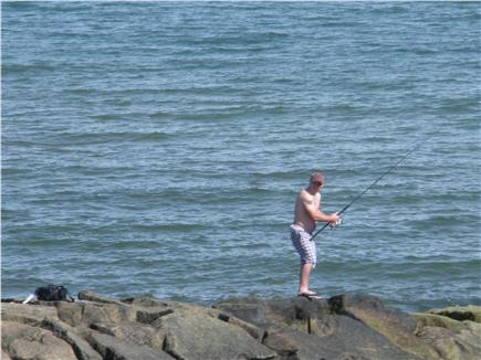 Dennis Port Cape Cod vacation rental - Fishing from the jetty at Sea Street Beach-100 feet from cottage