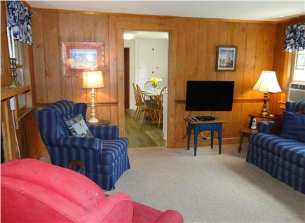 West Yarmouth crowell and seag Cape Cod vacation rental - Living room with flat screen TV, decorative fireplace
