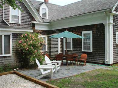 Wellfleet Cape Cod vacation rental - From kitchen to backyard patio facing lawn off of Main Street