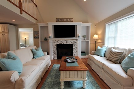 Barnstable Cape Cod vacation rental - Vaulted Living Rm w/Built-Ins, Flatscreen TV & Gas Fireplace.
