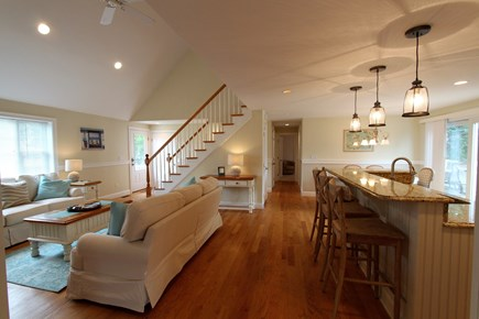 Barnstable Cape Cod vacation rental - Living area looking into kitchen