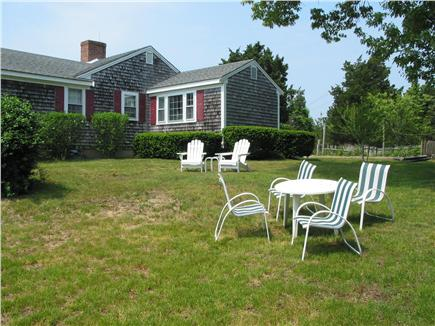 Eastham Cape Cod vacation rental - Large side yard for evening relaxation (including fire pit)