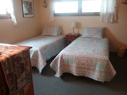 Next to Fisher Beach, Truro, C Cape Cod vacation rental - First bedroom showing night stand with lamp.
