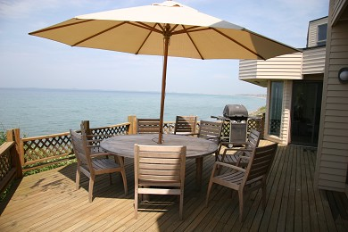 North Truro Cape Cod vacation rental - Main deck with teak table and umbrella