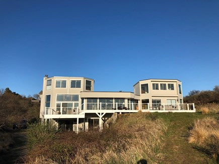 North Truro Cape Cod vacation rental - House facing Bay beach from edge of cliff