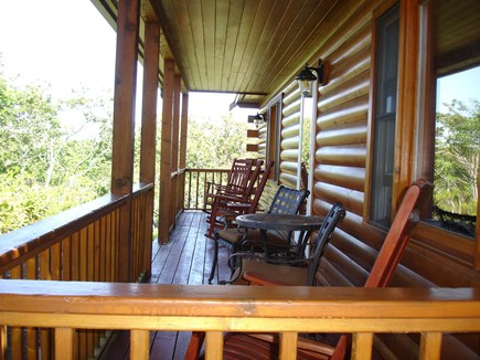 Provincetown Cape Cod vacation rental - Four oversized rocking chairs overlook Shankpainter Pond.