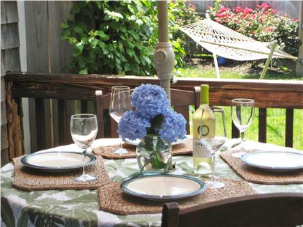 Sandwich, Town Neck Beach and Boardwalk Cape Cod vacation rental - Outdoor dining area on side porch