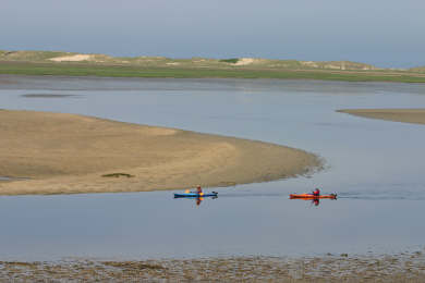 Chequessett Neck Wellfleet Cape Cod vacation rental - Kayakers float in front of our private beach at low tide.