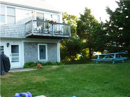 Dennis near Mayflower Beach Cape Cod vacation rental - Deck overlooking yard and picnic table