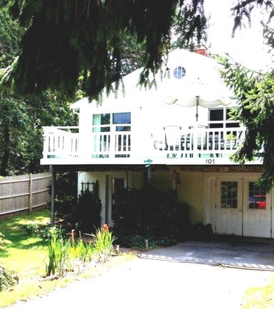 Wellfleet Cape Cod vacation rental - Front of house set behind trees, for privacy.