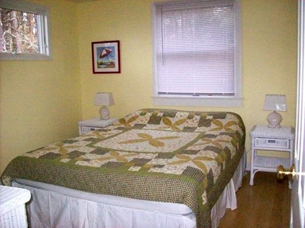 Wellfleet Cape Cod vacation rental - Second bedroom with white wicker furniture and queen bed.