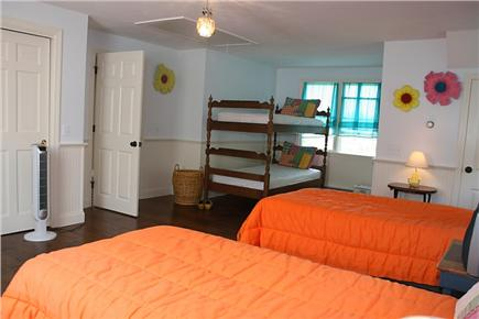 Harwichport Cape Cod vacation rental - View of large upstairs bedroom containing 5 twin beds.