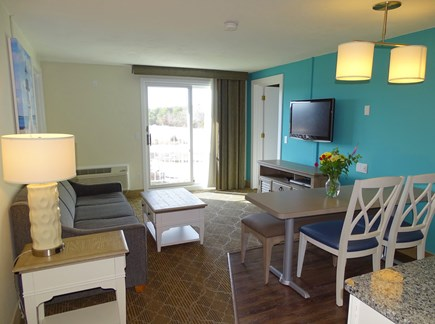 South Yarmouth Cape Cod vacation rental - Living area with couch, TV, slider towards river
