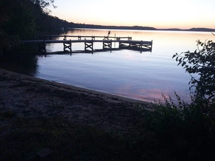 Harwich Cape Cod vacation rental - Sunset at the waterfront looking out to the dock the lake.