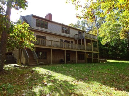 Harwich Cape Cod vacation rental - Back of house showing decks, walk-out