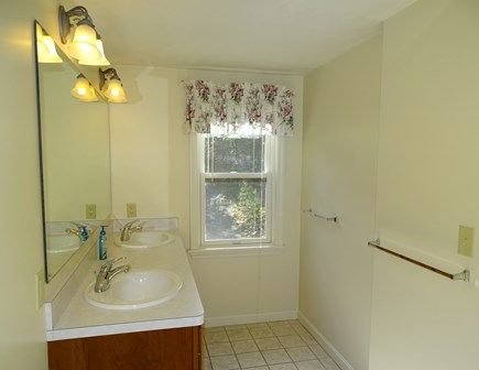 Harwich Cape Cod vacation rental - Each Bathroom offers double sinks, separate shower and tub room