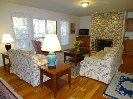 Harwich Cape Cod vacation rental - Living room with River Rock fireplace, sliders to deck