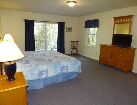Harwich Cape Cod vacation rental - Master bedroom with slider to deck, private bath