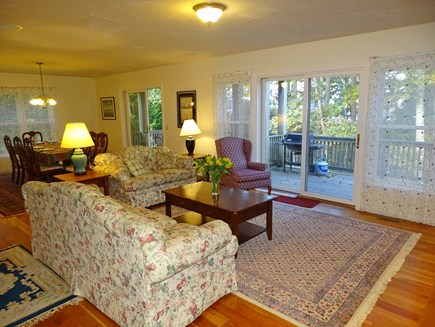 Harwich Cape Cod vacation rental - Living room opens to dining area, deck and outside grill