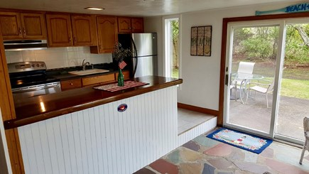 West Yarmouth-Lewis Bay Cape Cod vacation rental - Kitchen overlooking patio.