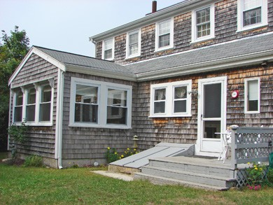 Hyannis Cape Cod vacation rental - Private fenced back yard with picnic tables and deck
