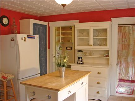 Hyannis Cape Cod vacation rental - Colorful kitchen with access to deck and back yard