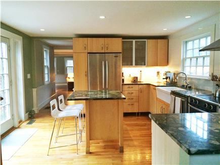 Brewster Cape Cod vacation rental - Then into the kitchen that opens onto a large patio.