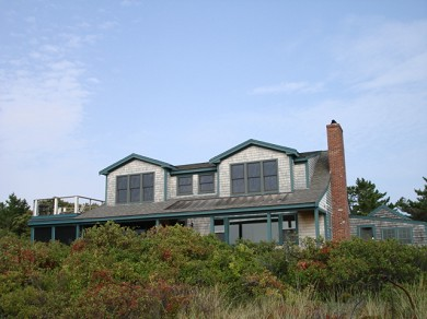 Wellfleet Cape Cod vacation rental - This beach side home peeking out looking at the Bay