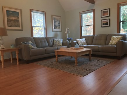 Eastham Cape Cod vacation rental - Spacious living room with cathedral ceiling, new leather couches
