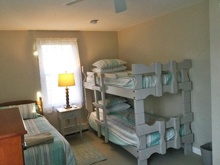 Forest Beach, South Chatham Cape Cod vacation rental - 2nd floor bunk room: New carpet, A/C, TV, DVD, decor. Paddle fan.