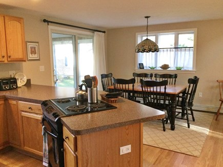 Forest Beach, South Chatham Cape Cod vacation rental - Dining area (seats 7 to 8) with adjacent furnished screen porch.