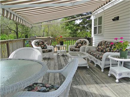 Brewster, old historic district Cape Cod vacation rental - Deck with rollout canopy, overlooks yard and playset