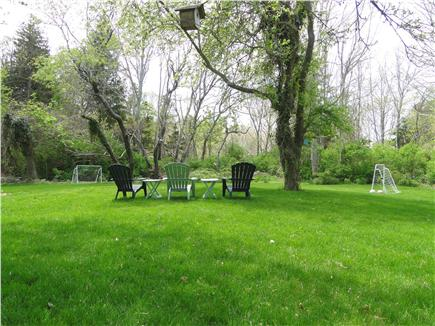 Brewster, old historic district Cape Cod vacation rental - Very large back yard with soccer nets and other games.