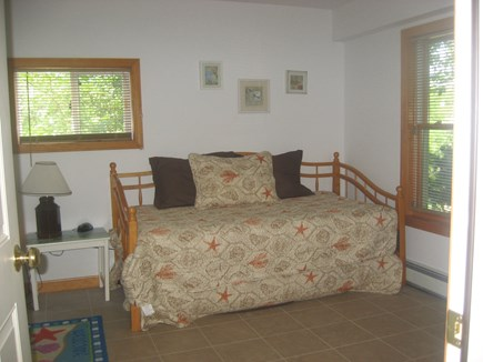 Eastham Cape Cod vacation rental - 1st floor den showing trundle bed/seating for TV watching.