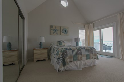 Barnstable Cape Cod vacation rental - Queen bedroom w/private oceanfront deck & vaulted ceilings.