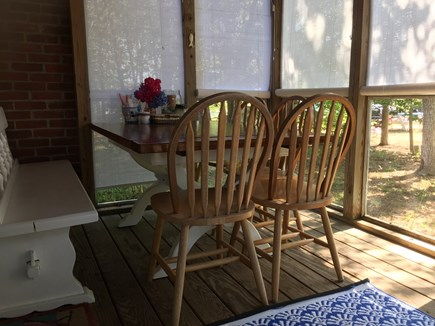 South Harwich Cape Cod vacation rental - Screened porch with expandable dining table that seats 6-8