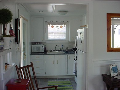 South Harwich Cape Cod vacation rental - Fully equipped kitchen w/sliders to three season porch