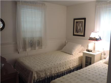 South Harwich Cape Cod vacation rental - Front bedroom with two twin beds, bureau and cable TV