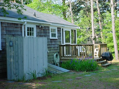 South Harwich Cape Cod vacation rental - Private, level lot with 8' picnic table, BBQ and outdoor shower