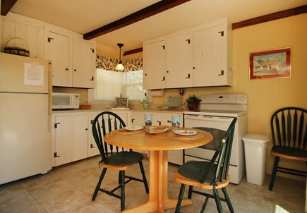 Hyannisport Cape Cod vacation rental - eat-in kitchen has cape cod cabinets and is fully equipped