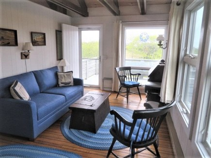 Lookout Bluff, N Truro Cape Cod vacation rental - Upstairs den beneath open beamed ceiling, with doorway to deck.