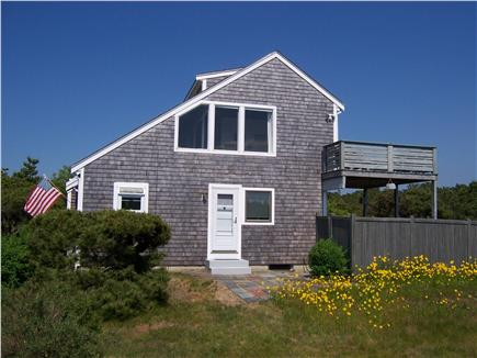 Lookout Bluff, N Truro Cape Cod vacation rental - Exterior of house, showing patio's fence and upper deck.