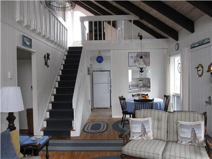 Lookout Bluff, N Truro Cape Cod vacation rental - Stairway, dining area, kitchen.