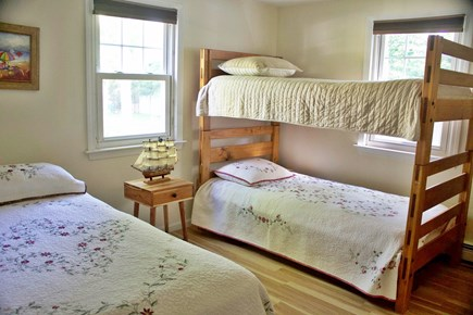 Mashpee Cape Cod vacation rental - First-floor bedrooms include bunk beds and twin-sized trundle bed
