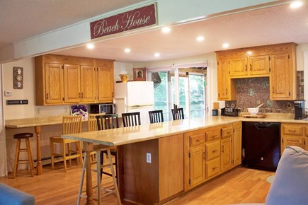 Mashpee Cape Cod vacation rental - Kitchen with breakfast bar dining; opens to screen porch