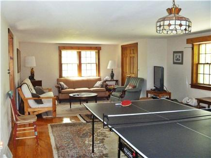 Barnstable Village Cape Cod vacation rental - Spacious family room with pullout sofa & ping pong table & organ